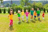 Runnig children at summer camp in the summer outdoors