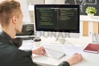 Man coding in office