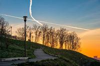 Public city park in sunset light
