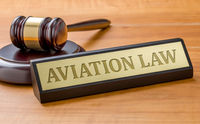 A gavel and a name plate with the engraving Aviation law