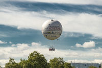 Paris, France, 2019-04 :  A tethered helium balloon, used as tourist attraction and advertising supp