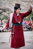Woman dancing on festival in Ladakh