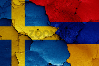 flags of Sweden and Armenia painted on cracked wall