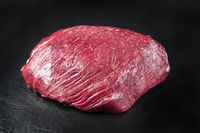 Raw dry aged wagyu thick flanch knuckle as closeup on black background with copy space