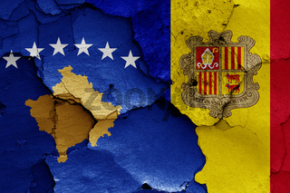 flags of Kosovo and Andorra painted on cracked wall