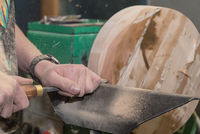 Carpenter turns with chisel - close-up