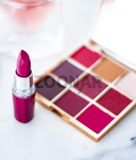 Cosmetics, makeup products on dressing vanity table, lipstick, foundation base, nailpolish and eyeshadows for luxury beauty and fashion brand ads design
