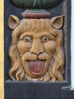 Goslar - Grotesque face, 'Neidkopf', wood carving on a half-timbered house, Germany