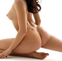 Beautiful brunette in splits nude profile portrait