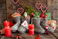 Knitted boots with candy and presents