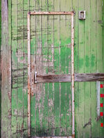 Wooden Damaged Garage Door