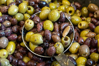 Seasoned black and green olives