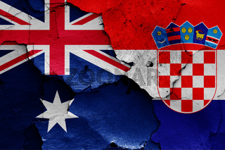 flags of Australia and Croatia painted on cracked wall