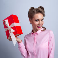 Woman holding christmas box
