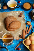 Gingerbread dough placed among various ingredients. Christmas baking concept