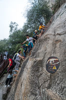 Climbers tackling steep stone stairs on Huashan mountain