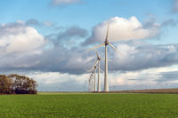 Huge wind turbines in Dutch agricultural landscape