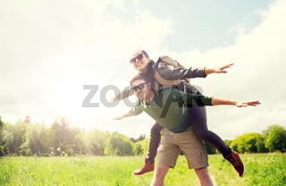 happy couple with backpacks having fun outdoors