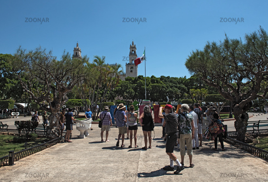 group of tourists on the plaza de la independencia in merida mexico