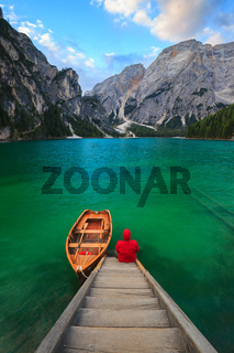 Man alone at the Braies Lake, Italy
