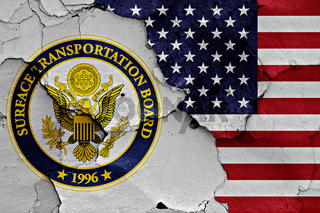 flags of Surface Transportation Board and USA painted on cracked wall