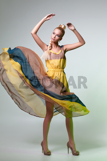 beautiful girl in dress posing like doll