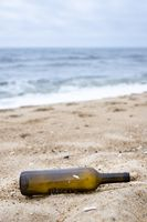 Nazare, Portugal - Empty wine bottle washed up on the shore