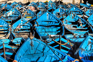 Lots of blue fishing boats in the port of Essaouira, Morocco