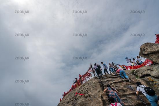 Crowds reaching summit of West Peak in Huashan mountain