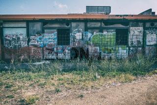 Graffiti covering outside walls of an abandoned club.