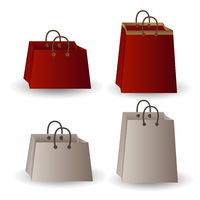Set of four party favor gift white and red paper with gold ribbon bags isolated on white background.