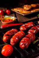 Chili chorizo sausage with tomato bruschetta