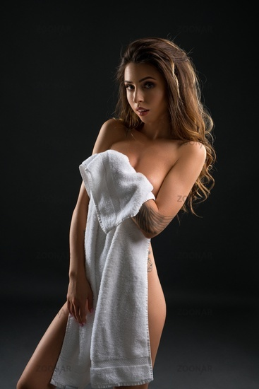 Sexual attractive young woman posing with towel