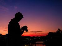 Photographer shooting photo at dusk. Thailand.