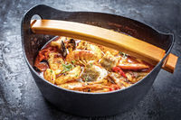 Traditional Italian American cioppino fish stew with prawns