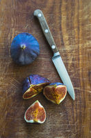 figs on wooden board with knife