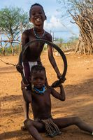 Hamer tribe kids playing with tire
