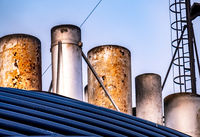 Close up of chip vessel exhaust pipes and chimneys