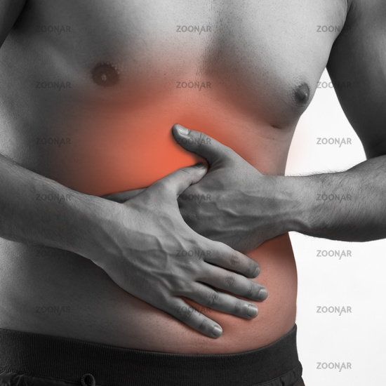 Man suffering from acute pain on abdomen