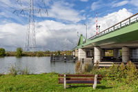 Dutch landscape with steel bridge over river Vecht