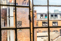 Old, rusty, open window in the old factory, UK