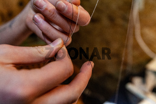 Fashion designer making a knot