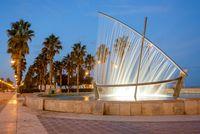 Boat fountain at the Malvarrosa beach Valencia, Spain