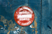 A close up view of a sign on a garage door saying