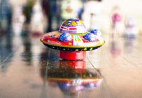 retro tin UFO on a old wooden floor