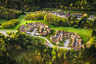 Small village seen from above surrounded by forest