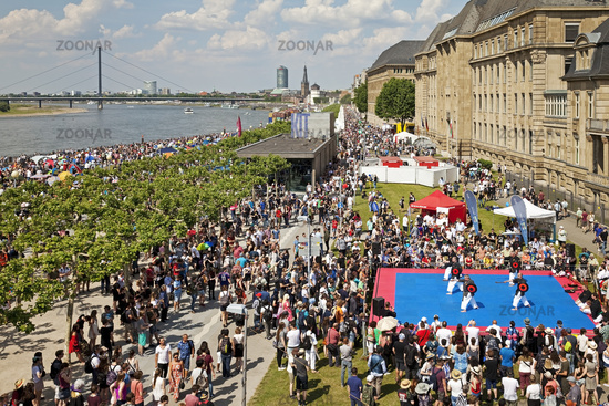 tourists on the Rhine embankment promenade on the Japan Day, Duesseldorf, Germany, Europe