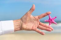 Starfish in hand business man