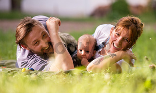 hipster family relaxing in park