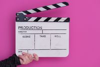 movie clapper on pink background